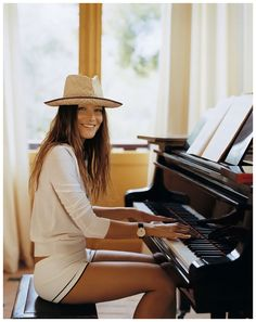 Carla Bruni plays piano (2007). Covers ELLE magzine. January 2008. Photo Gilles Bensimon.Bruni, fomer supermodel and now singer, spent a holiday with her new boyfriend, French President Nicolas Sarkozy, in Luxor, Egypt.The circumstances of the stay in Egypt were controversial. An Egyptian member of Parliament accused his government, which planned an official reception of the unmarried couple, of a bad moral example and the official acceptance of prostitution by state leaders.
