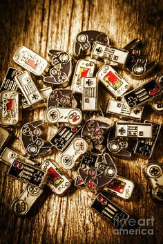 Creative abstract photograph on a scattered pile of gamer joysticks and control pads. The art of antique games by Jorgo Photography - Wall Art Gallery