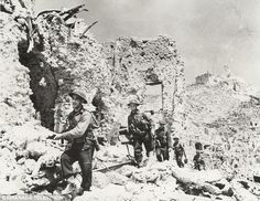 Attack: Scenes during the Allied Invasion of Italy in World War Two, as British troops pick their way through the ruins of the Italian village of Cassino, where Rfn Savage is commemorated on a memorial