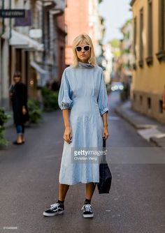 Linda Tol wearing a babyblue dress and Vans during Milan Fashion Week Spring/Summer 2017 on September 25, 2016 in Milan, Italy.