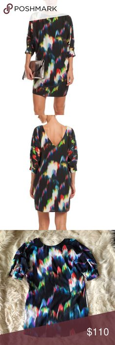 Trina Turk Naideen 100% Silk dress Trina Turk Aurora Borealis print Naideen Dress. 100% silk crepe de chine. Features dolman sleeves, a deep v-back and flattering boatneck. Effortless pullover style. Trina Turk Dresses