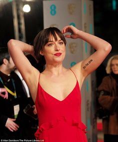 Meaningful: Dakota's arm tattoo reads Acta Non Verba, which means 'deeds not words' in Latin
