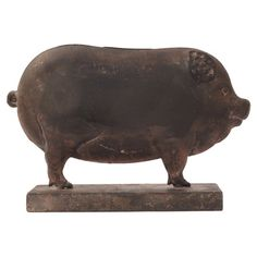Bring farmhouse style home with this whimsical pig decor, showcasing a weathered finish for rustic appeal.   Product: Decor...