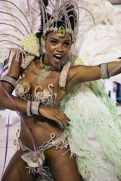 Rio de Janeiro Carnival. Woman (mulata) dancing for Grande Rio Samba School, at the Sambodrome Carnival parade.