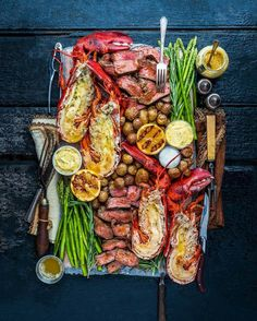 Woodfire-grilled surf & turf platter with prime-grade tenderloin steak fresh Mai… - Seafood Seafood Recipes, Cooking Recipes, Seafood Bbq, Seafood Party, Grilled Seafood, Grilled Lobster, Steak And Seafood, Tenderloin Steak, Seafood Platter