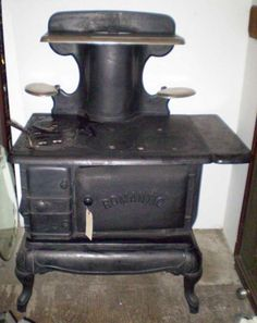 Grandma's kitchen had her cast iron cook stove next to her modern electric stove.  I was allowed in the kitchen to help with the cooking & cleaning.....I can remember her putting the wood the stove.