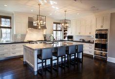 White Kitchen. Transitional White Kitchen with Dark stained Hardwood Floors. #WhiteKitchen #Kitchen #TransitionalKitchen Designed by John Johnstone Kitchen & Bath Designers.