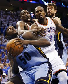 Memphis' Zach Randolph (50) looks to get the ball past Oklahoma City's Serge Ibaka (9) and Kendrick Perkins (5) near Memphis' Marc Gasol (33) during Game 2 in the first round of the NBA playoffs between the Oklahoma City Thunder and the Memphis Grizzlies at Chesapeake Energy Arena in Oklahoma City, Monday, April 21, 2014. Memphis won 111-105 in overtime. Photo by Nate Billings, The Oklahoman