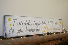 Twinkle twinkle little star do you know how loved you are?  This is a wood sign that measures 36 x 8. The background is painted vintage white