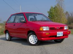 Ford Festiva first vehicle I bought by myself when I came back from Germany, it was totaled by the guy across the street when it was parked in front of his house