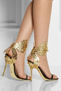 Rossi's gorgeous butterfly sandals as jewelry for your feet. This beautifully crafted satin and metallic leather pair features intricate cutouts and a sculpted gold-tone embellishment. Let them shine against a simple black dress.