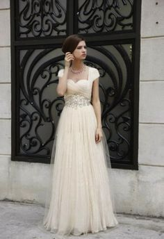 sweetheart cap sleeve wedding gown. this is perfect