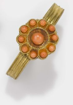 A 19th century coral and gold bangle