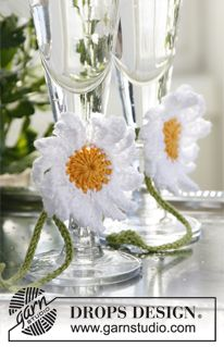 """DROPS 17th May: Crochet marguerites in """"Safran"""" with leaves. Free pattern!"""