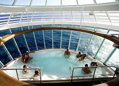 Cantilevered hot tub extends out over the side Royal Caribbean's Liberty of the Seas.