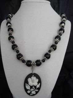 Black and silver necklace with flower cameo by bluecrownjewels, $25.00