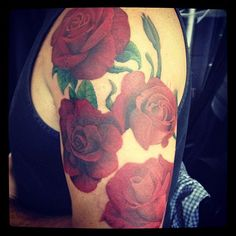 red realistic roses tattoo