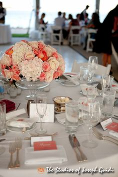 coral and white centerpieces and place setting with menus