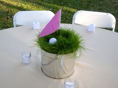 "golf themed centerpieces | ... golf ""hole"" for each table, using a mini golf flag, a tee and golf"