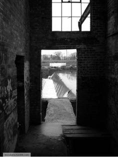 A dam waterfall from inside Ypsilanti Michigans empty paper mill  #abandoned #waterfall #inside #ypsilanti #michigans #empty #paper #mill #photography