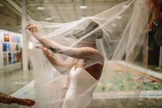 Feeling wistful with a beautiful bride and her floating veil at Artists For Humanity in Boston, MA www.afhboston.org I Photo by Lisa Rigby Photography www.lisarigbyphotography.com