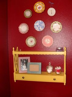 a coat of sunny yellow paint was the key to this cottage facelift for my shelf.  ...can't help but give props to my saucer collection, as well