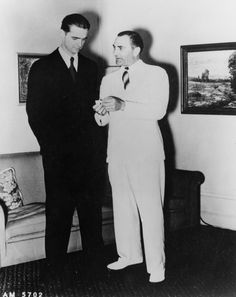 Lockheed Vice President Carl B. Squier (pictured right) talking with Howard Hughes in the Main Street Lockheed Air Terminal, ca. 1940. Coralie Hewitt Tillack Collection. San Fernando Valley History Digital Library.
