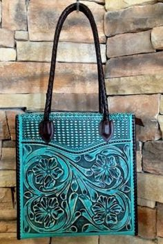Tooled leather bag by Appaloosa Trading.