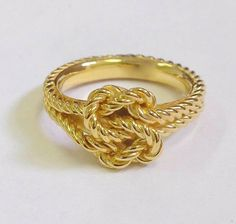Nautical woven ring comfort fit know at the true Lovers Knot. 14k or 18k yellow or white gold. Any size available #nauticalgoldjewelry