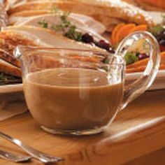 Make-Ahead Turkey Gravy Recipe from Taste of Home -- The base for this flavorful gravy is prepared with turkey wings and can be prepared in advance. (or anytime you want some yummy gravy) —Linda Fitzsimmons, Fort Edward, New York Thanksgiving Gravy, Thanksgiving Recipes, Holiday Recipes, Thanksgiving 2017, Thanksgiving Sides, Christmas Desserts, Dinner Recipes, Turkey Recipes, Chicken Recipes