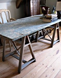 """Old door used as a table top with a trestle leg base. Would be great as a HS table for """"Idea Lab"""" where HS students will spend apps 20% of their time developing and tracking their ideas."""