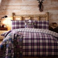Offering night-long comfort, this bedding set is made from pure brushed cotton flannelette which creates a beautifully soft and smooth finish. Inspired by traditional tartan fabrics, it features contrasting checked prints in warm purple hues.