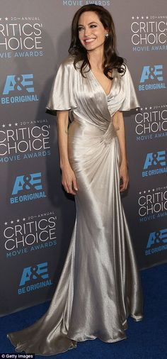 Film noir: Angelina's outfit looked like something a dame would wear in a Raymond Chandler novel in a Versace metallic maxi dress