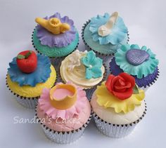 Collection of dome topped cupcakes inspired by Disney Princesses. Each cake represents one of the 6 princesses, with the colour scheme taken from her dress & finished with a hand modelled topper. I also included 6 cupcakes decorated with buttercream & coordinating flowers