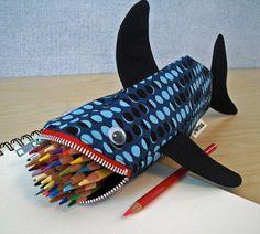 In Honor of Shark Week.  http://blog.shoplet.com/wp-content/uploads/2012/01/minne-bites-shark-pencil-case.jpg