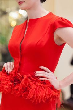 """Luly Yang's """"Pometini Suit"""" is made with a vibrant red silk. Its cap sleeves and peplum skirt make it perfect for a variety of occasions!"""