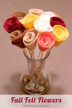 Create these fall felt flowers for a centerpiece, home decor item or Thanksgiving hostess gift.