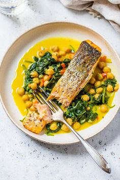 Seared salmon with spinach and chickpeas in a creamy coconut curry sauce is an easy one-pot meal that cooks in under 20 minutes! #salmon #onepot Salmon Recipes, Fish Recipes, Seafood Recipes, Dinner Recipes, Recipies, Pescatarian Recipes, Vegetarian Recipes, Healthy Recipes, Healthy Meals