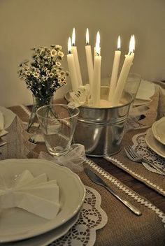 pretty table center ... tapers in a shiny metal pail of sand!  :)