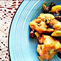 Stufato di coniglio con uva bianca e olive taggiasche