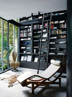 House tour: a farmer's refurbished Melbourne apartment in an old shoe factory - Vogue Living Dark, sensuous, earthy tones prevail in this sleek, Melbourne apartment by Fiona Lynch. Black Bookshelf, Black Shelves, Bookshelf Ideas, Bookshelf Design, Bookshelves, Modern Bookshelf, Vogue Living, Lounge Design, Lounge Decor