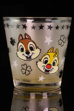 """Chip and Dale, the penultimate Disney cartoon couple, will bring a smile to anyone who drinks from this 12 oz glass tumbler. 3 1/4"""" at it's widest, 3 1/4"""" tall."""