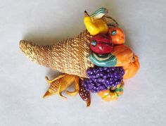 A very detailed cornucopia, all made with polymer clay. You have to see it to believe it. www.etsy.com/shop/hookedonclay