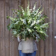 Wild and relaxed vintage milk churn design. Image by Janne Ford. Flowers created by Eden Blooms Florist from Eucalyptus, Olive, Green Bell & White Delphinium.