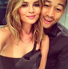 """The always-candid Billboard Music Awards co-host, admitted to Giuliana Rancic that she had a spray tan mishap prepping for the show.  """"It matches John's hands as well because he was touching my breasts apparently in the middle of the night."""" Her husband, John Legend joked,""""That's what happens when married couples sleep together."""" Performing @johnlegend and wife @chrissyteigen hosting! Hot couple covered in spray tan! Lol, she's a riot! #BBMAs .@chrissyteigen reveals her spray tan mishap…"""