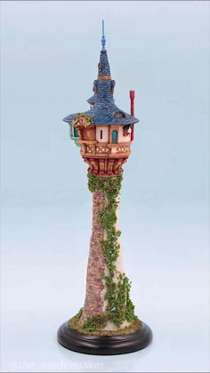This is scale model of Rapunzel Tower inspired by Disney movie Tangled. It was originaly scratchbuilt as engagement ring box but I can make you one as movie collectible. It is very rare because painting process takes a lot of time. #tangled #rapunzel #tower #disney #disneyland #scalemodel #diy Tangled Party, Tangled Rapunzel, Ring Boxes, Movie Collection, Disney Crafts, Painting Process, Disney Movies, Scale Models, Ideas Para