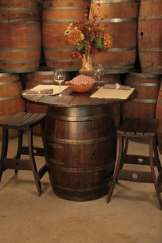 PUB TABLE: A genuine retired wine barrel base with a round top constructed from 1″ thick oak. Easily seats four. Price includes a cabinet door and shelf for interior storage! http://www.katybarrelcompany.com/product/pub-table-2/