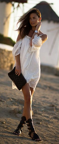 Zina Charkoplia is wearing a dress from Sheinside, sandals from Dolce & Gabbana and a clutch from Miu Miu