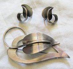 "Vintage 1940s 50s Paul Lobel sterling silver brooch and earrings set - the pin measures about 3"" across."