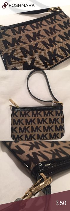 Michael Kors logo Wristlet Michael Kors logo Wristlet. Excellent condition except couple minor barely visible scratches on a bottom of zipper (last photo). I didn't actually use it, maybe once, but not quit sure. Has a slot for credit card inside. Patent leather strap. Michael Kors Bags Clutches & Wristlets